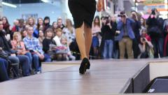 Stock Video Footage of Thin slim model girl legs on catwalk fashion clothes show and camera flashes