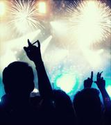 New Year concept - cheering crowd and fireworks - stock photo