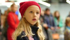 Stock Video Footage of Cute face blonde little girl in red hat in audience spectator watching a show