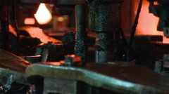 hot glass being transformed into glass bottles - stock footage