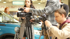 Paparazzi - camera operators and photographers - the process of shooting Stock Footage