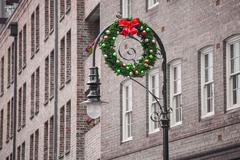 Christmas ring hang on streetlights - stock photo