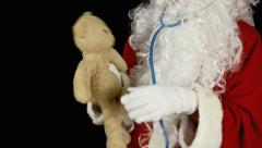 Santa Claus teddy bear caress - stock footage