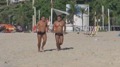 Jogging on Copacabana Beach Stock Footage