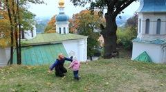 Mother with her daughter play in the monastery Stock Footage