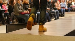 Stock Video Footage of Young guy model walking on catwalk on the fashion clothes show