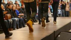 Stock Video Footage of Young guy models walking on catwalk on the fashion clothes show