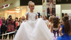 Stock Video Footage of Little girl model walking on catwalk on the fashion clothes show