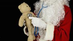 Santa Claus teddy bear doctor Stock Footage