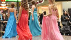 LIttle girl models walking on catwalk on the fashion clothes show - stock footage
