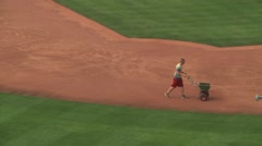 Worker preparing baseball diamond for gameplay Stock Footage