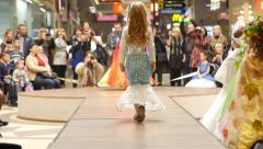 LIttle girl models walking on catwalk on the fashion clothes show Stock Footage