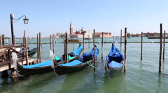 Gondolas docked to the poles on the Grand Canal in Venice, Italy Stock Footage