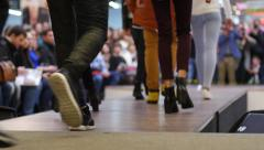Stock Video Footage of Young model legs walking on catwalk on the fashion clothes show