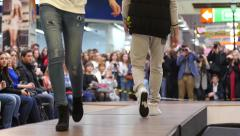 Young girl models walking on catwalk on the fashion clothes show Stock Footage