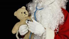Santa Claus teddy bear medical exam - stock footage