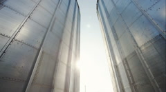 Silver, shiny agricultural silos. Two of the tower and between sun Stock Footage