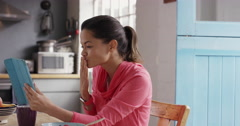 Beautiful mixed race woman talking to boyfriend over internet using digital - stock footage