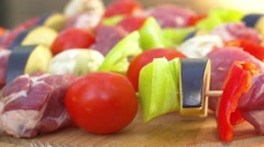 Assorted meat from chicken, pork and various vegetables for barbecue on cutting - stock footage