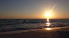 Small drone flying with birds at sunset on the beach Stock Footage
