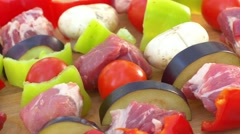 Assorted meat from chicken, pork and various vegetables for barbecue on cutting Stock Footage