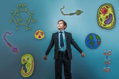 Stock Photo of boy looking up serious businessman opened his arms Icons biology