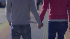 Gay Couple Hold Hands And Walk Across Rainbow Colored Crosswalk In San Francisco Stock Footage