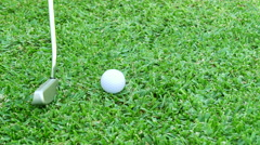 Hitting a golf ball with putter Stock Footage