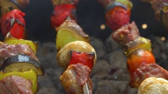 Skewers with delicious kebabs or barbeque on brazier, cam moves to the right Stock Footage