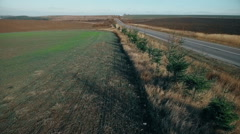 Aerial view of fields and the roadside Stock Footage