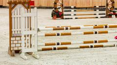 Equitation. Obstacle for jumping horses. Stock Photos