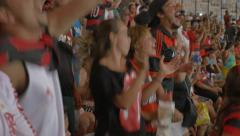 Fans chanting at football match Stock Footage