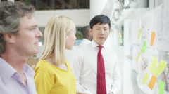 4K Creative design business team brainstorming for ideas with sticky notes - stock footage