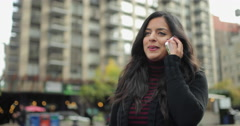 Young Indian woman in city talking on cell phone Stock Footage