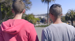 Gay Couple Walk (Backs To Camera) In Dolores Park, San Francisco Stock Footage