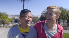 Gay Couple Talk/Laugh And Walk Toward Camera In Park, San Francisco - stock footage
