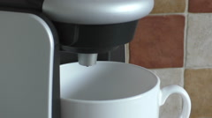 Coffee maker brewing a hot drink - stock footage