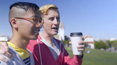 Gay Couple Drink Coffee And Walk Around Dolores Park, San Francisco Stock Footage