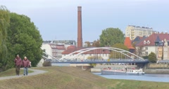 People Are Walking by Alley at Odra Embankment Woman with Baby Pram People are Stock Footage