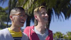 Happy Gay Couple Talk/Walk Along Palm Tree Lined Path In San Francisco Stock Footage