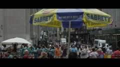 Busy NY crowd with umbrella up close Stock Footage