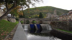 River with Gates, Stone Bridge and Church Stock Footage