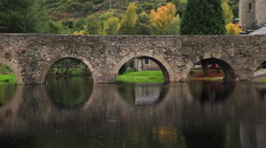 Arch stone bridge in the River - stock footage