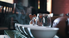 Traditional chinese tea ceremony on the tea table, close up, pan Stock Footage