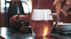 Pouring tea in glass, slow motion, dolly. Tea ceremony on the table Stock Footage