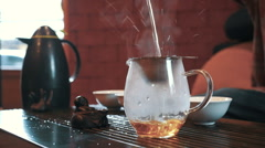 Traditional chinese tea ceremony on the tea table, close up, slow motion Stock Footage