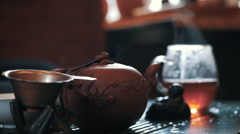 Traditional chinese tea ceremony on the tea table, close up Stock Footage