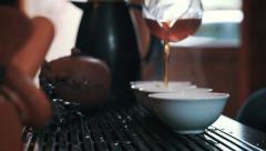 Master of tea pouring tea in pialas, rack focus Stock Footage