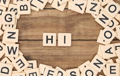 Hi spelled out in tan tile letters - stock photo
