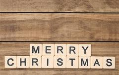 Merry Christmas spelled out in tan tile letters - stock photo